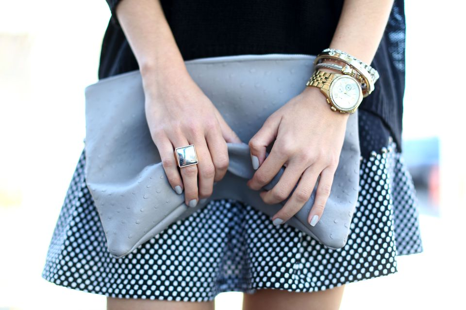 woman holding a clutch
