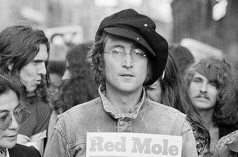 Portrait of British musician John Lennon (1940 - 1980) and his wife, artist and musician Yoko Ono (extreme left) as they attend an unspecified rally in Hyde Park, London, England, 1975.
