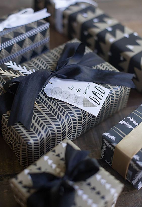 An assortment of gifts with modern wrapping paper