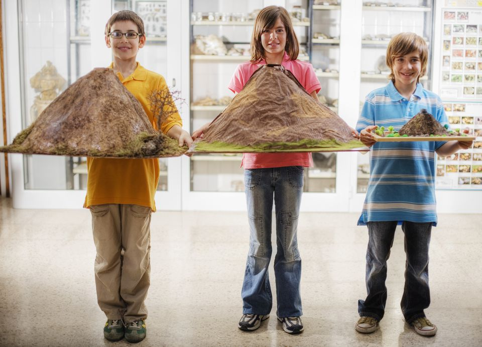 Students Holding Model Volcanos