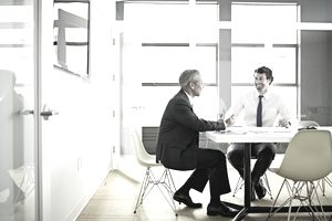 Businessmen having a conversation in a conference room