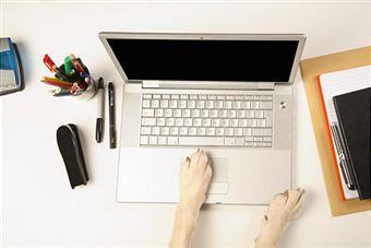 Dog paws on laptop keys