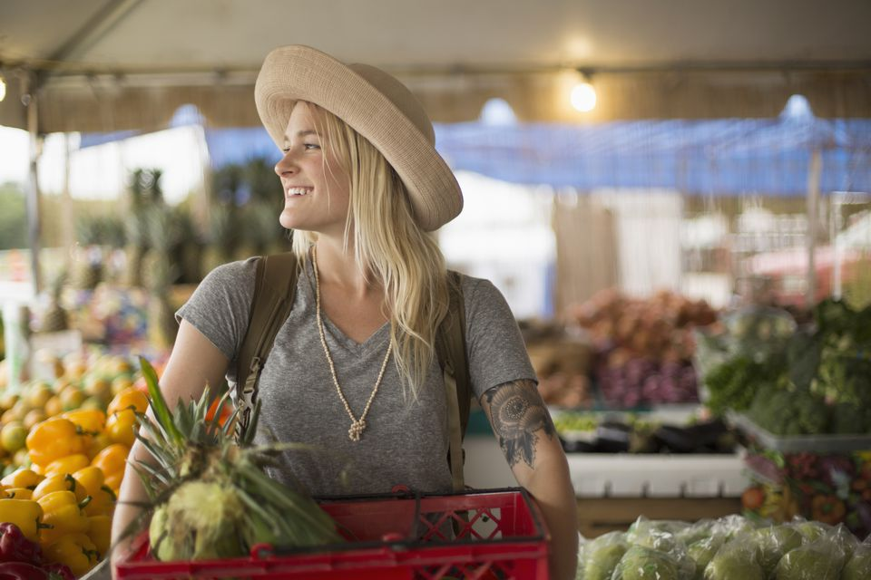 Caucasian woman shopping for produce in farmers market