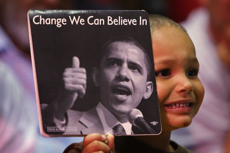Boy holding up Obama sign