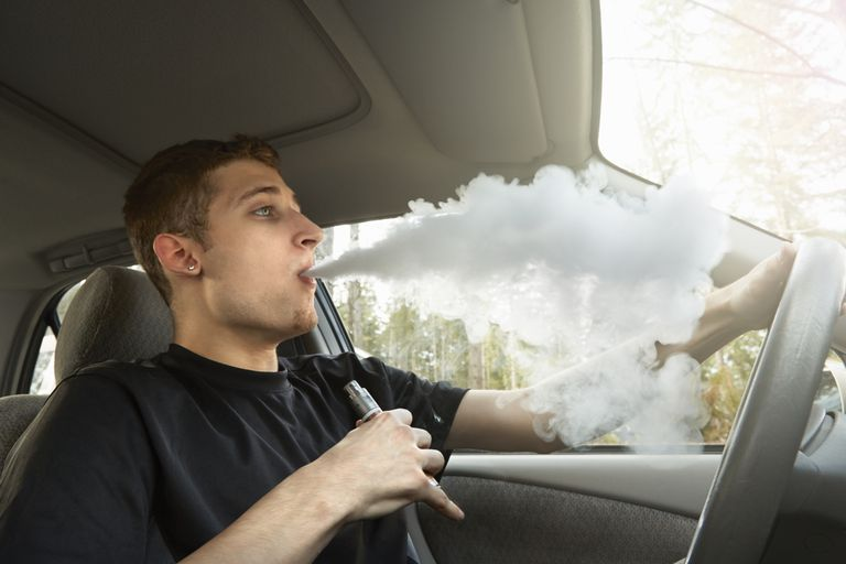 young man vaping and driving