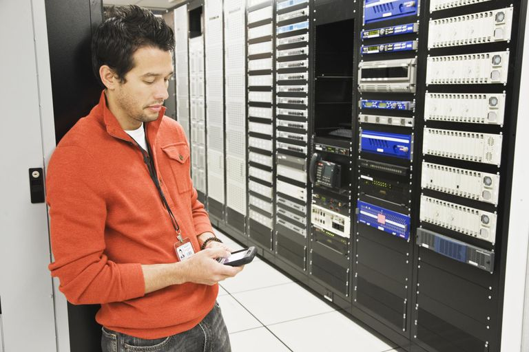 Technician using PDA in server room