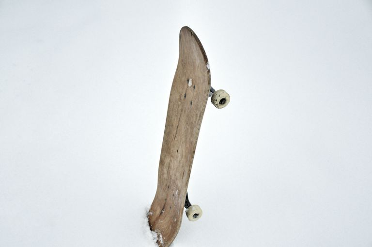 High Angle View Of Wooden Skateboard On Snow