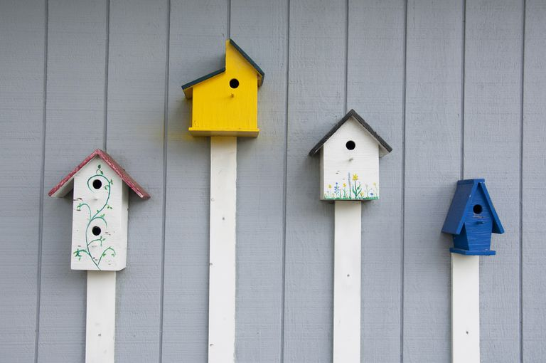 Four bird houses on wall, Beaufort, North Carolina, USA