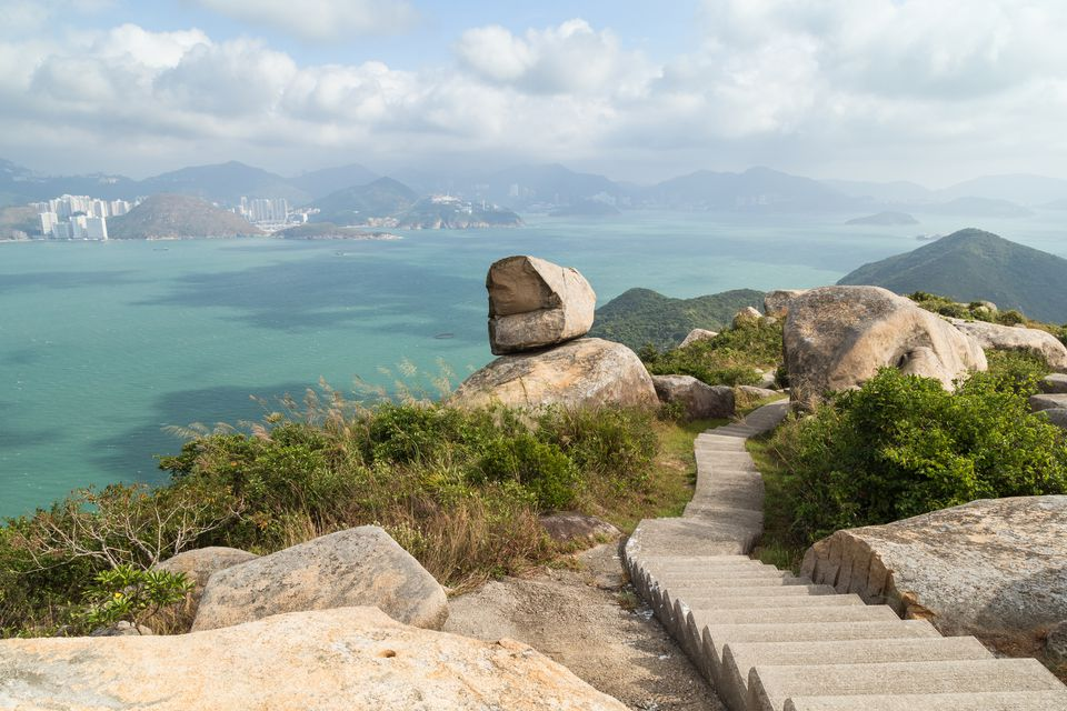 Scenic view of rocky landscape, stairs, ocean and Hong Kong Island from the Ling Kok Shan hill at the Lamma Island in Hong Kong, China