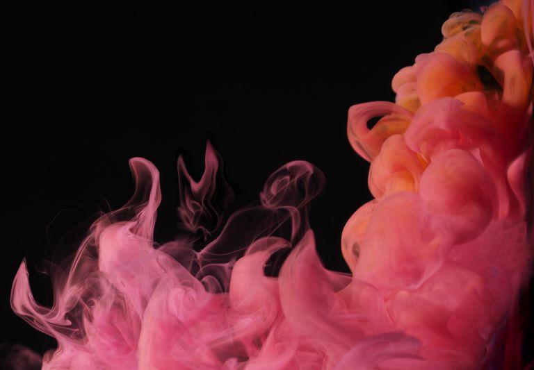 Make red or pink smoke by vaporizing an organic dye.