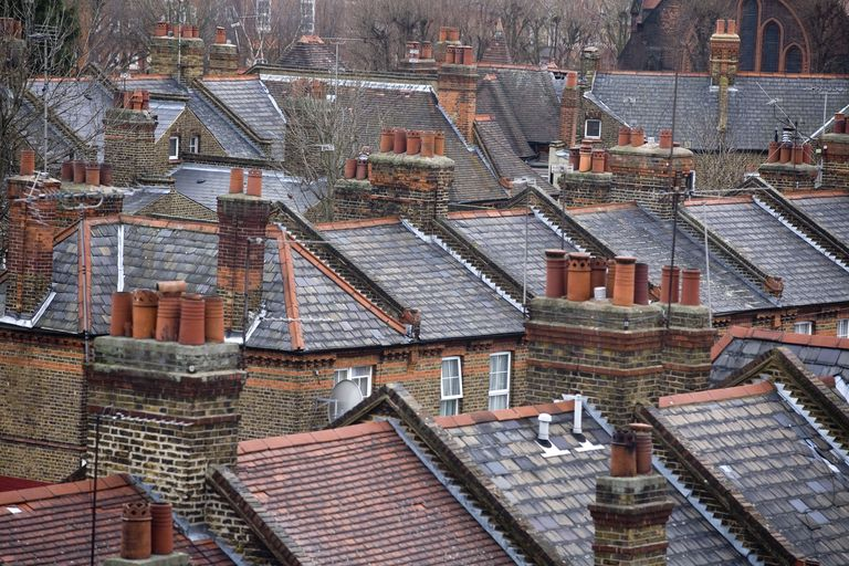 Overhead View of London rooftops with chimneys and chimney pot extnsions