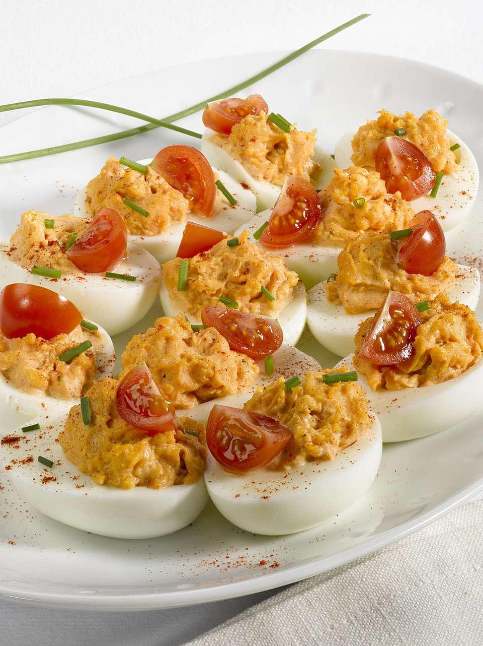 Delicious deviled eggs with tuna and tomato recipe.