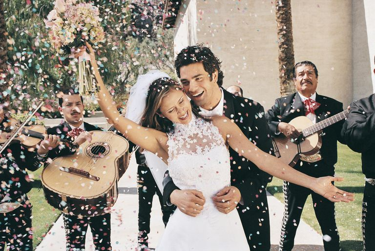 Bride And Groom Celebrating With Confetti A Mariachi Band