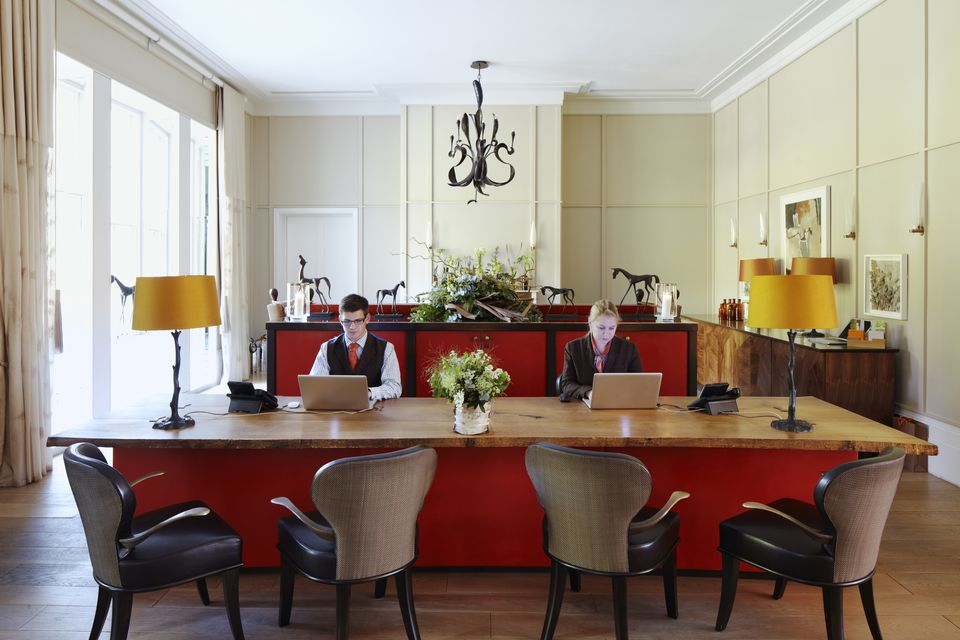 Two receptionists at hotel reception