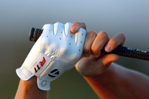 Golfer's grip pressure at top of his swing