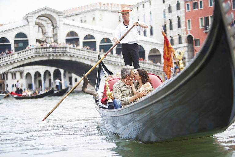 Couple on a gondola in Venice, Italy