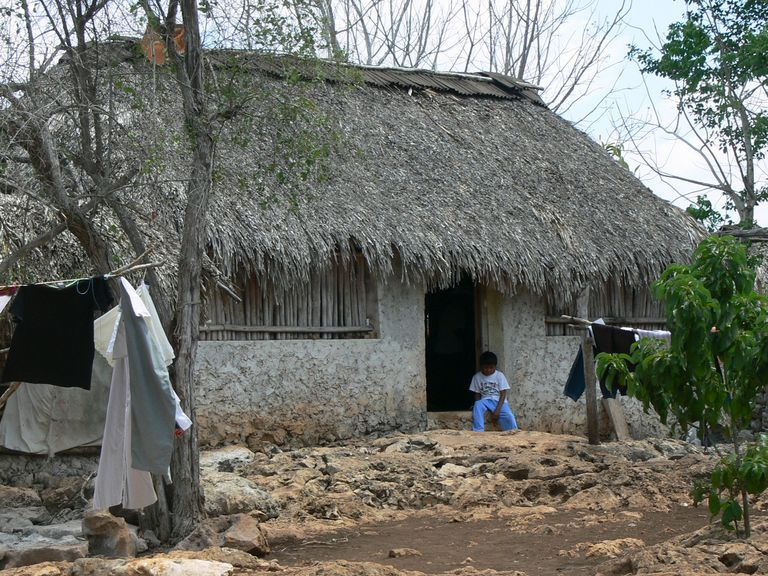 Mayan stone hut with thatched roof