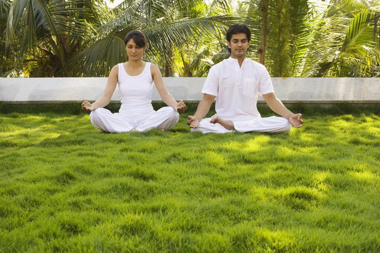 Woman and man seated in lotus pose