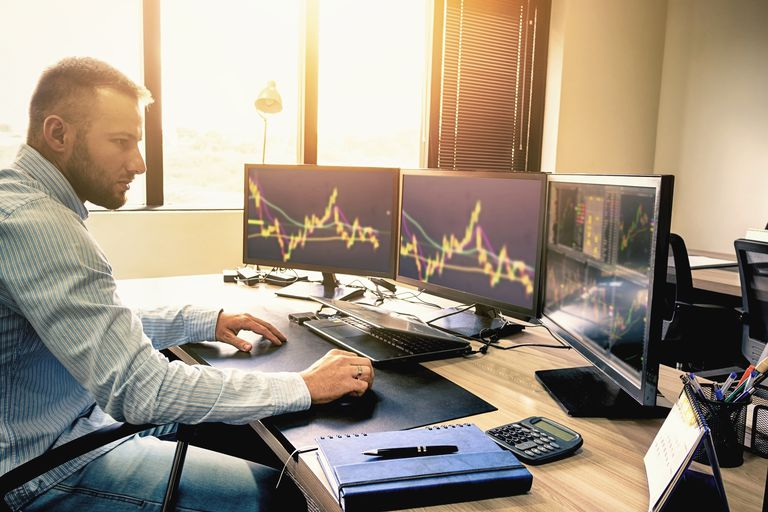Young business person trading stocks