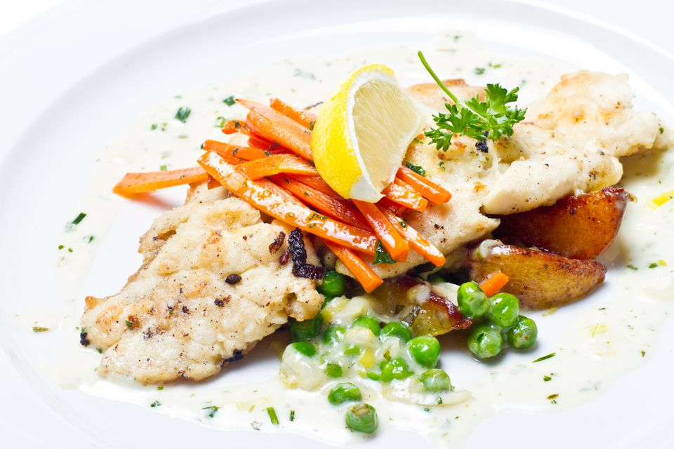 Trout with Lemon Cream Sauce served with carrots, peas and potatoes
