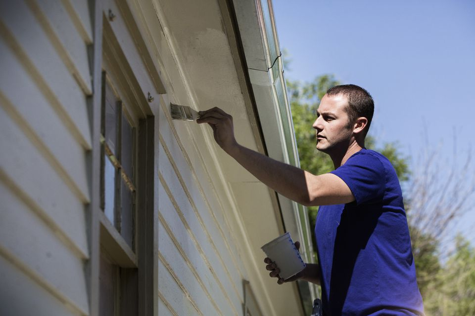 Man Painting House Exterior 519515491