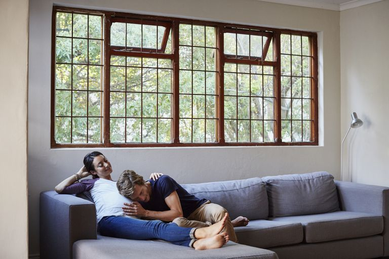 man and pregnant woman on couch