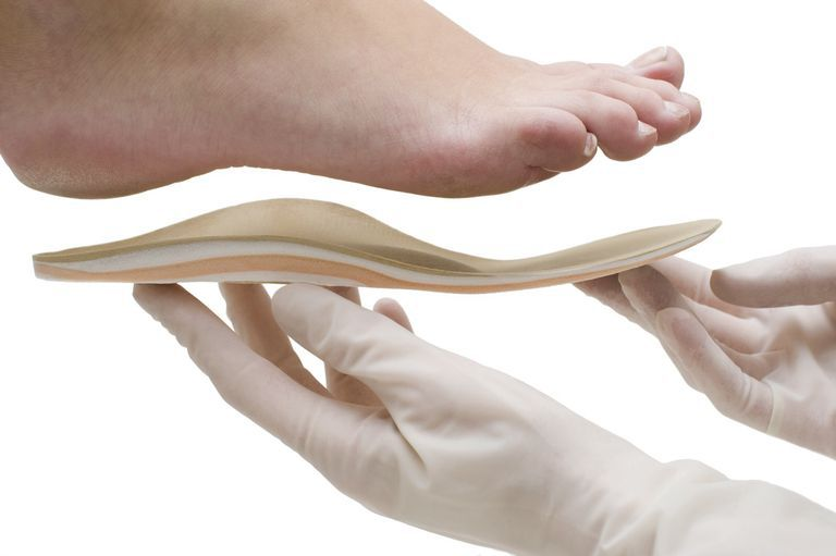 Photo of a foot orthotic to arch support.
