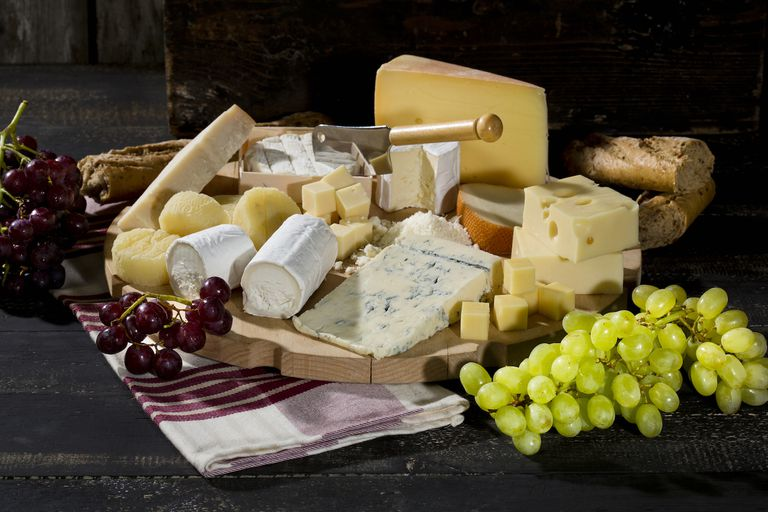 <strong>cheese</strong> platter with different sorts of cheese, baguette and