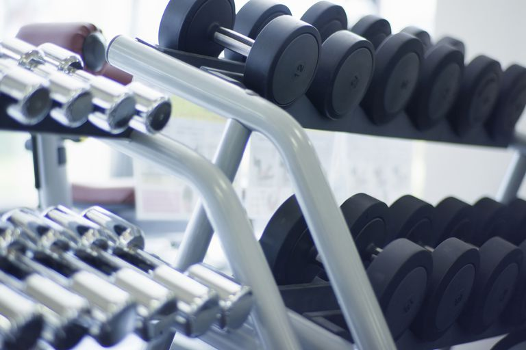 Racks of dumbbells.