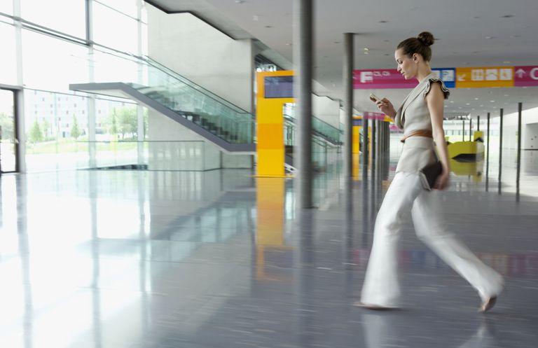 Businesswoman walking in convention center