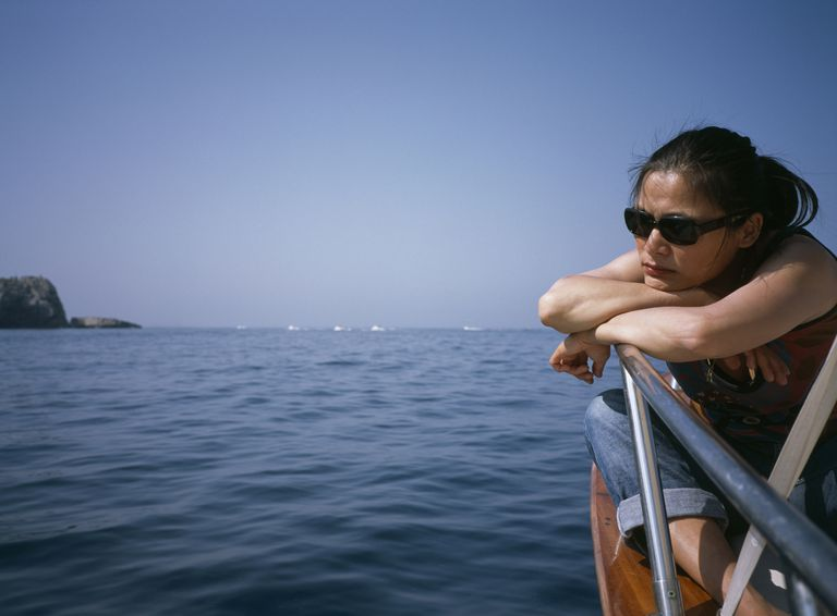 Woman seasick on a boat