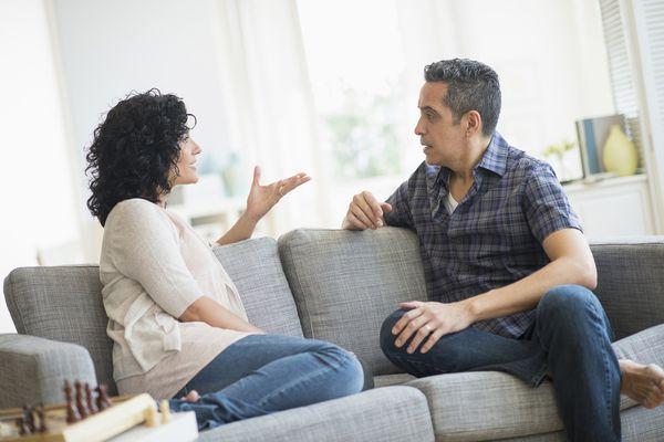 Couple talking on a sofa