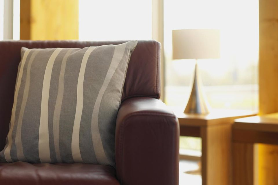 Close-up of an armchair in a living room
