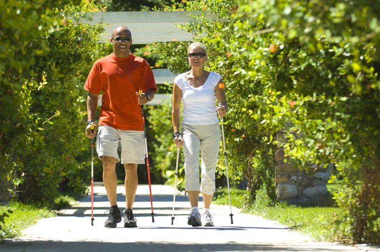 Nordic Walking Couple on Sidewalk