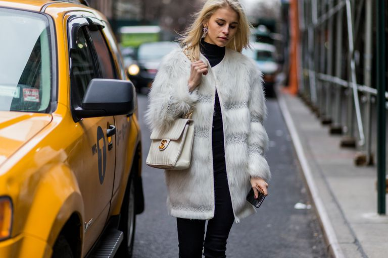 Street style faux fur and jeans outfit