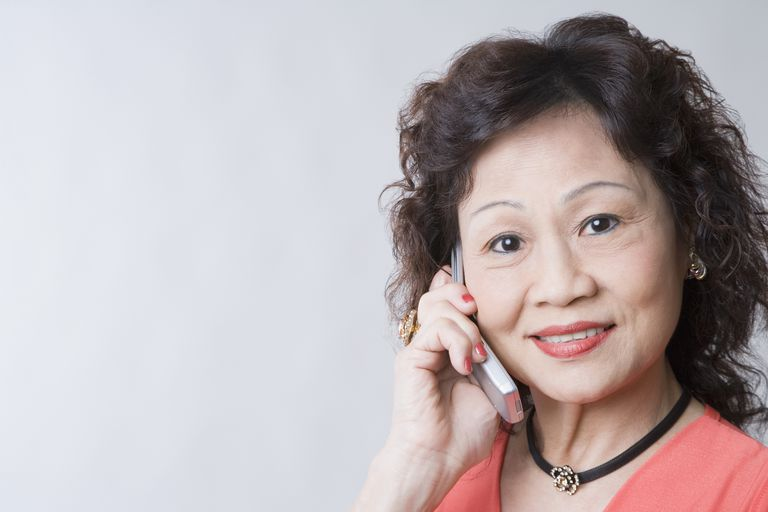 Portrait of a senior woman talking on a mobile phone and smiling