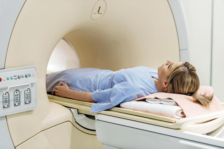 Mid adult woman receiving an MRI Scan.