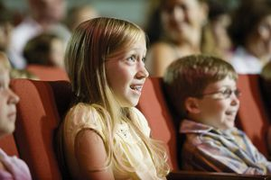 A photo of a girl and boy at a movie theater.