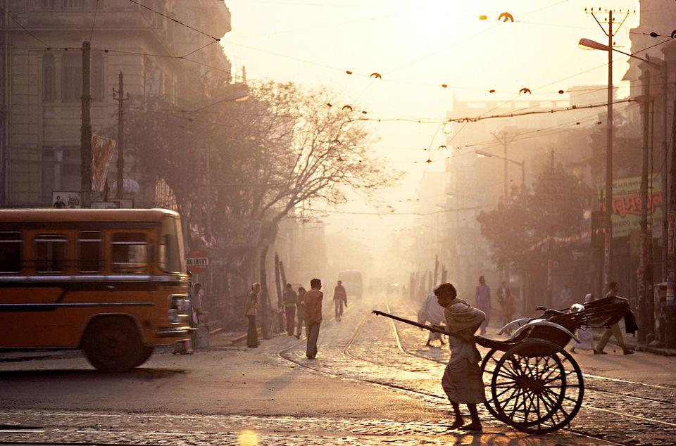 Rickshaw and street scene, Kolkata.