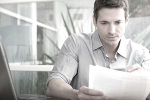 Man reading letter in office
