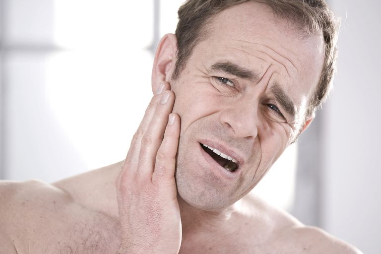 mature man with jaw pain