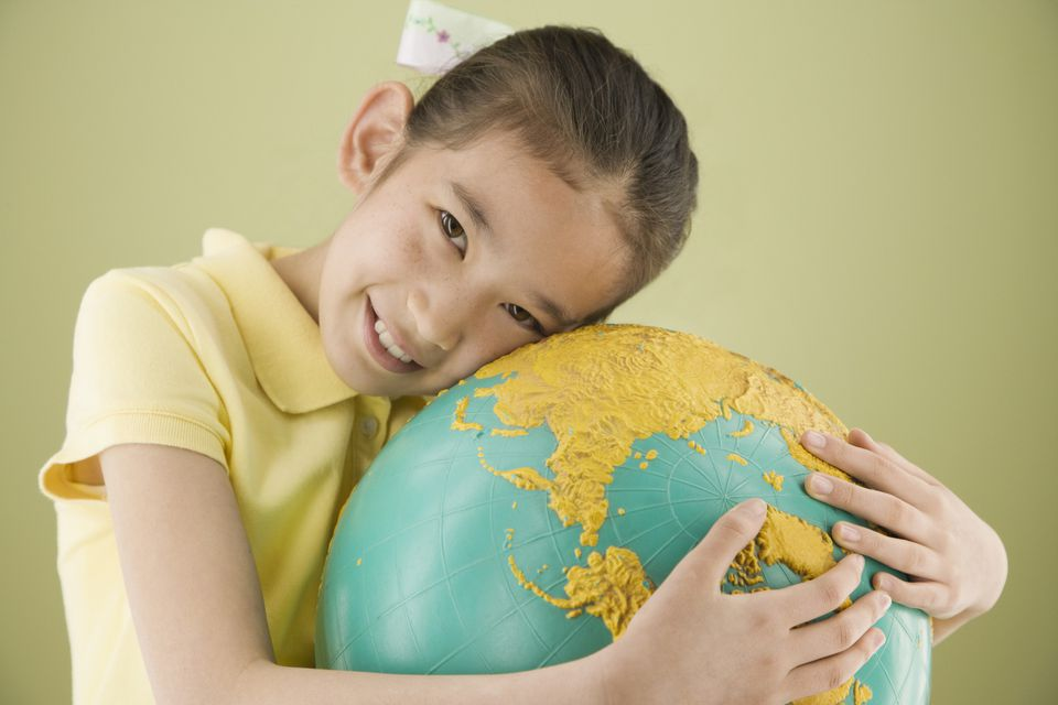 Girl hugging globe