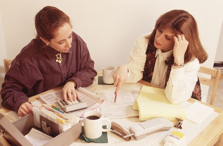 Women preparing taxes