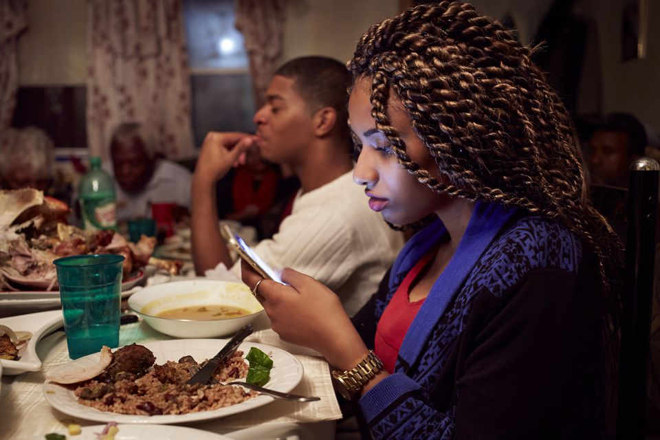 Cell phone at dinner table