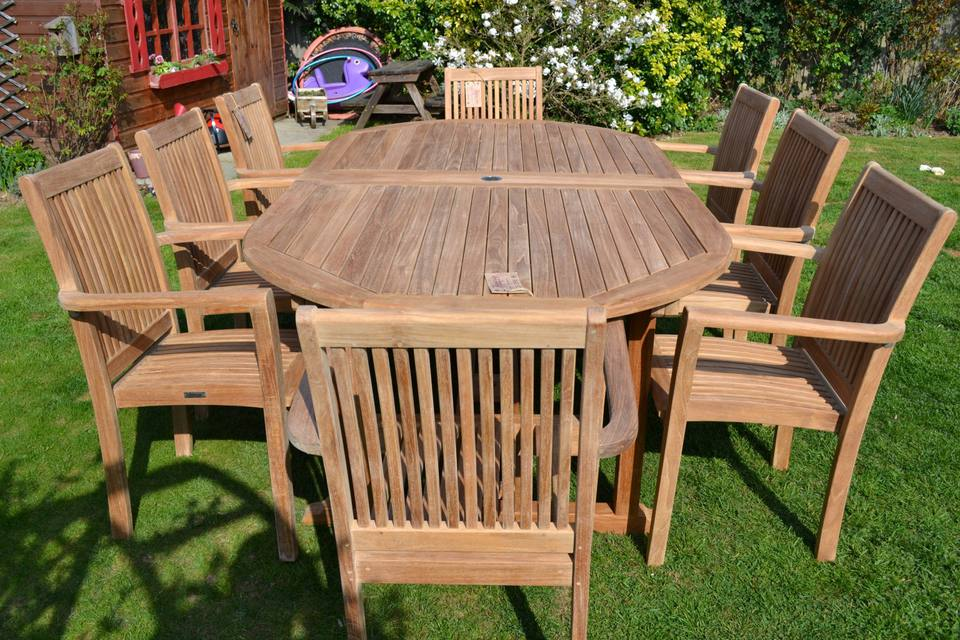 An outdoor wooden table, and a set of outdoor chairs