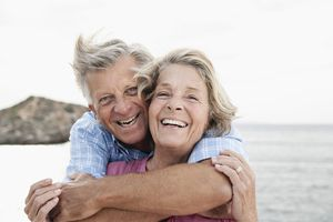 older couple smiling and embracing