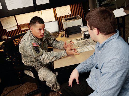 Army recruiter with potential candidate