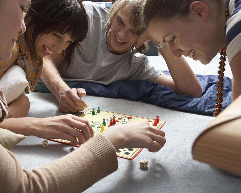 Teenagers (18-19) playing a board game