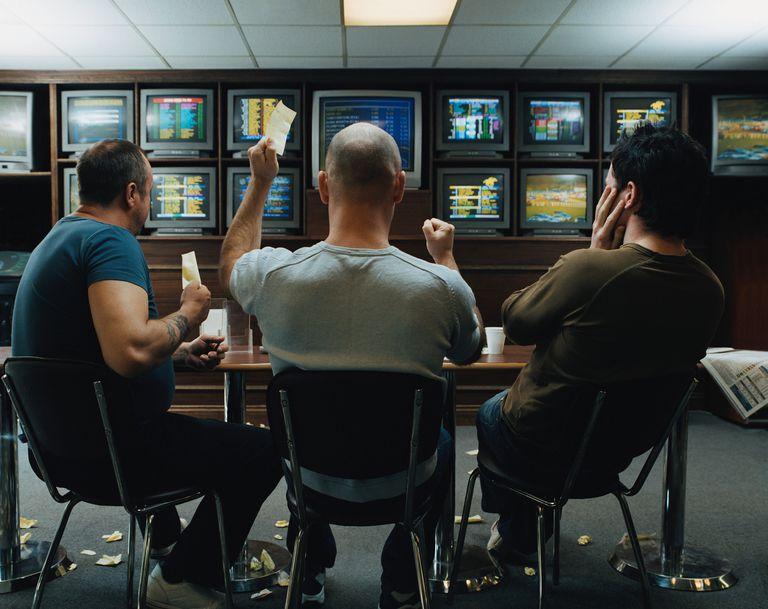 Three men in a betting shop