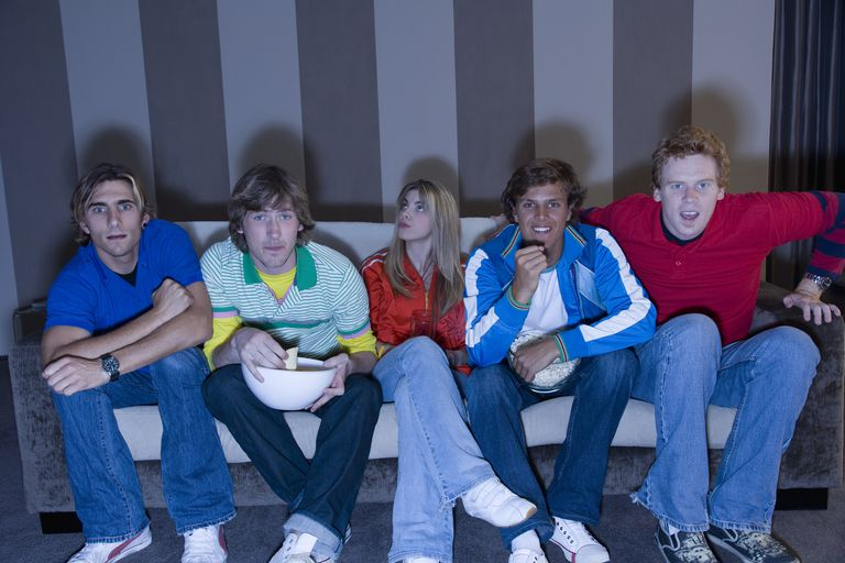Group of young adults watching a movie
